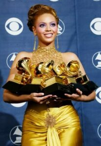 Beyonce knowles with her five Grammy Awards